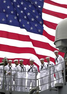 Sailors standing in front of American Flag