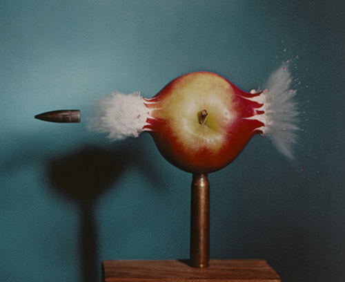 Bullet through apple image